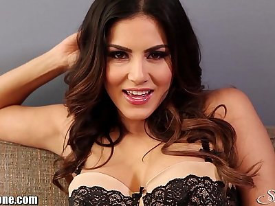 SunnyLeone Striptease on the couch